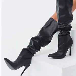Black knee high boots (never worn)